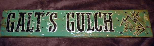 Silver ringed letters, Galt's Gulch logo, dollar sign